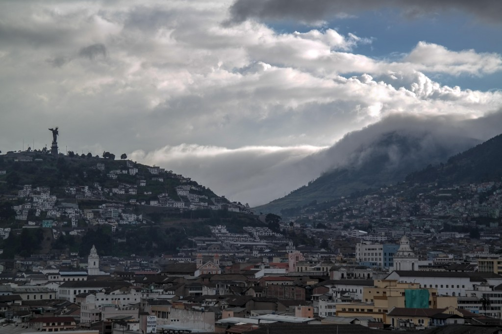 Clouds make there way over a nearby volcano as they head towards the city